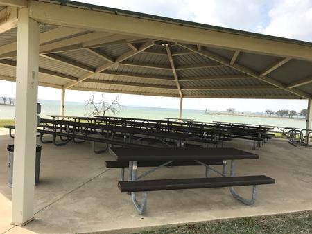 Picnic tables and seating in the Group Shelter pavilion