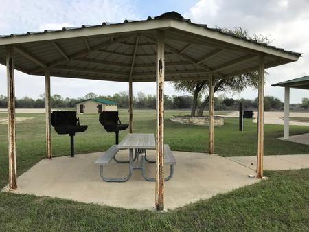 Two grills are located in Group Shelter Area with a restroom in the distance