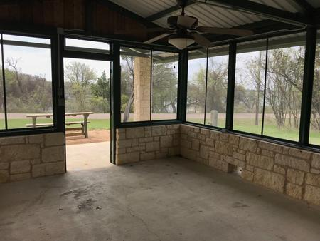 Interior of screen shelter with Waco Lake in background