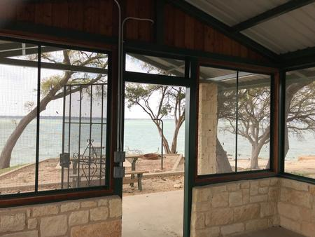 Interior of screen shelter with view of Waco Lake