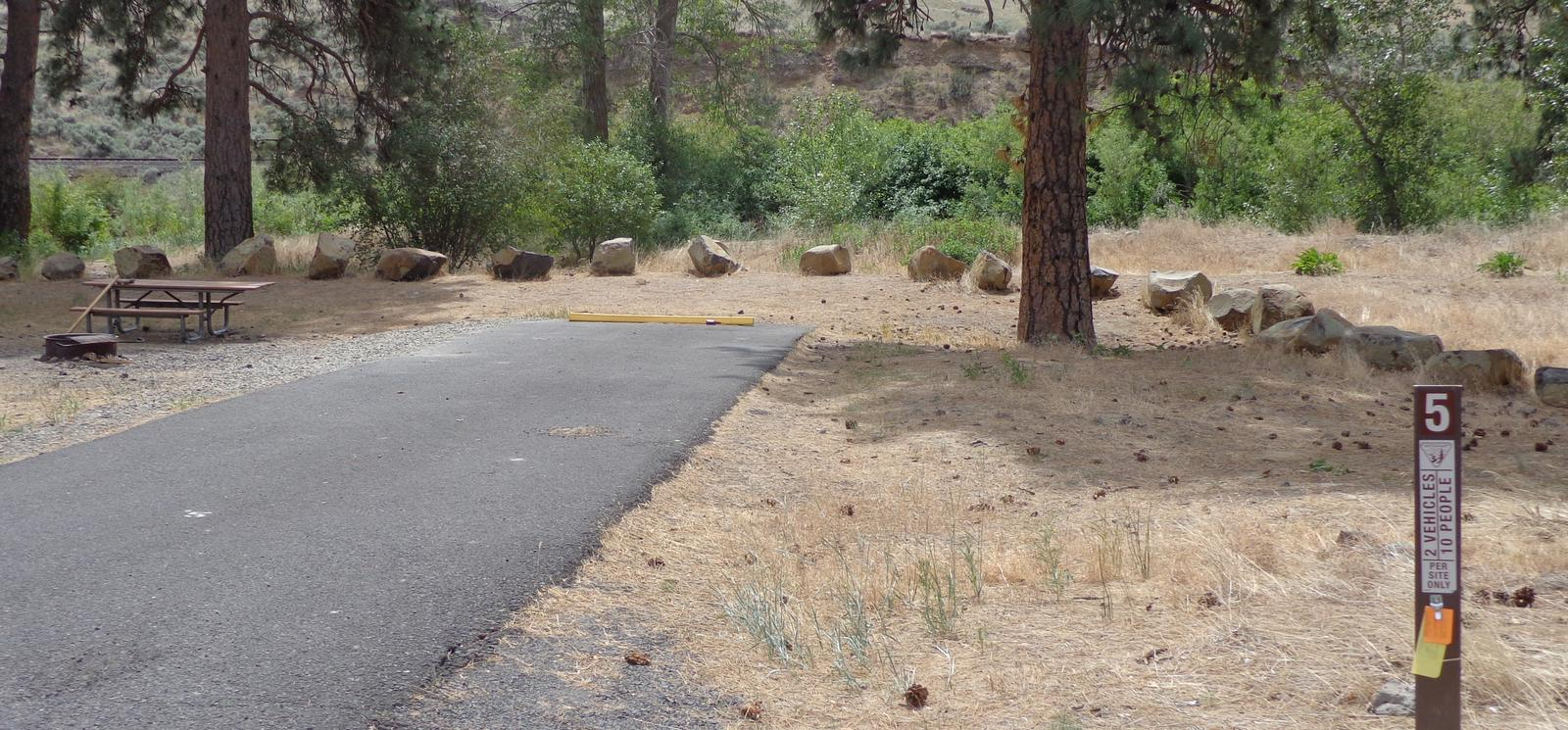 Parking pad, picnic table and fire ring at Big Pines Campsite #5Big Pines campsite #5