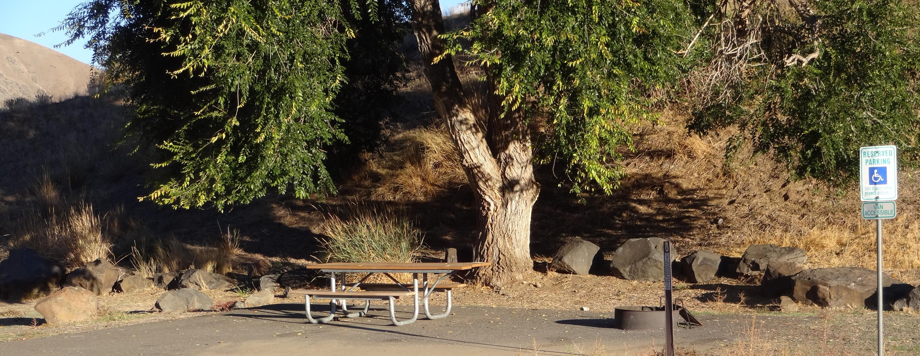 Parking spot, picnic table and fire ring at Lmuma Creek Campsite #6Lmuma Creek campsite #6
