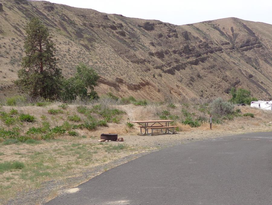 Parking pad, picnic table and fire ring at Big Pines Campsite #11