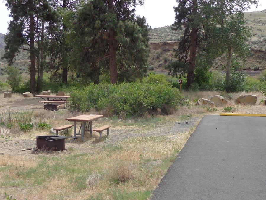 Parking pad picnic table and fire ring at Big Pines Campsite #14