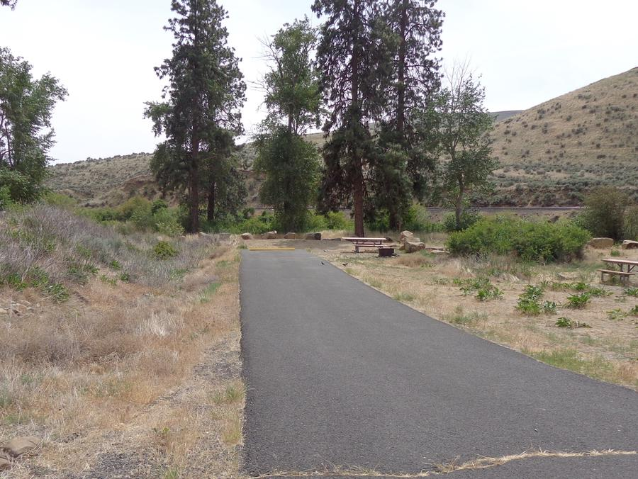 Parking pad, picnic table and fire ring at Big Pines Campsite #13