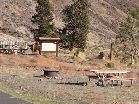 Parking pad, picnic table and fire ring at Big Pines Campsite #17
