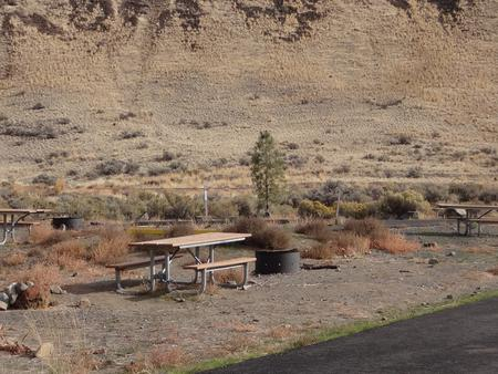 Parking pad, picnic table and fire ring at Big Pines Campsite #19