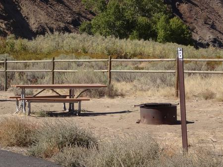 Picnic table, paved trail and fire ring at Big Pines Walk-in Campsite #B