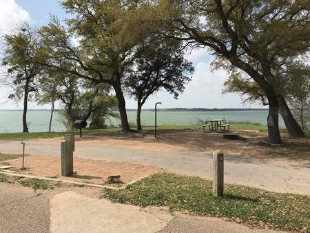 Pull through RV site with picnic table, grill, fire ring, and great view of Waco Lake