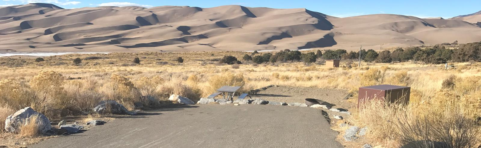 Wide view of Site #36 parking pad and designated tent pad. Great Sand Dunes in the background.Site #36, Pinon Flats Campground
