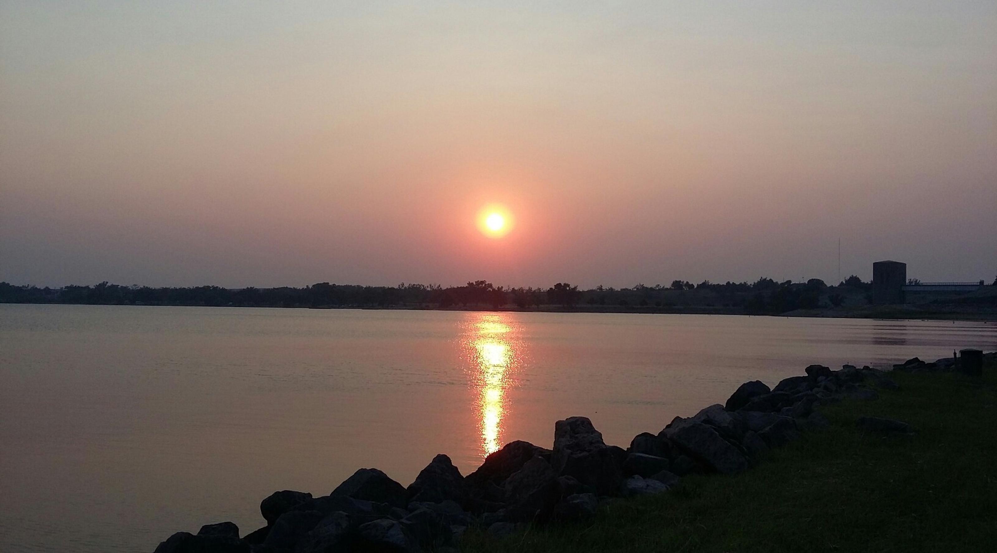 Lakeside Drive at sunsetSunset over Ft. Supply Lake