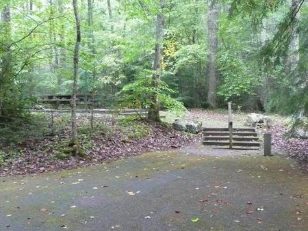 Secluded site behind hostCreek and woods.  Has stairs.