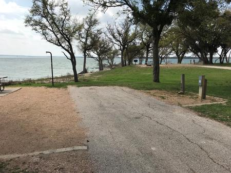 RV hookup area with Waco Lake in background