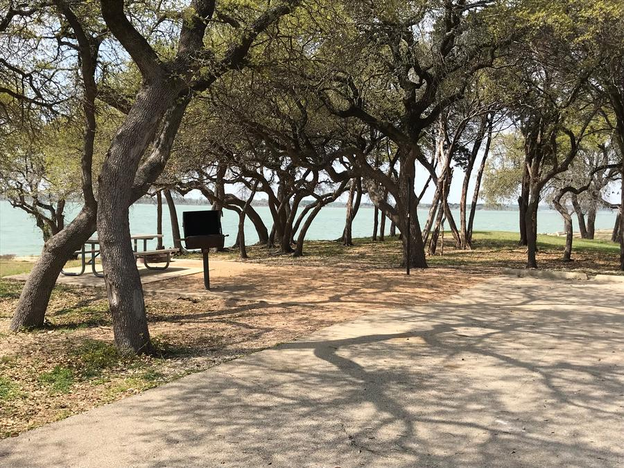 Picnic area at site with view of lake
