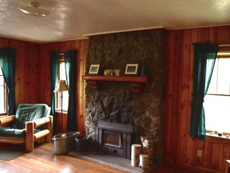 Stub Creek cabin living room with fireplace.
