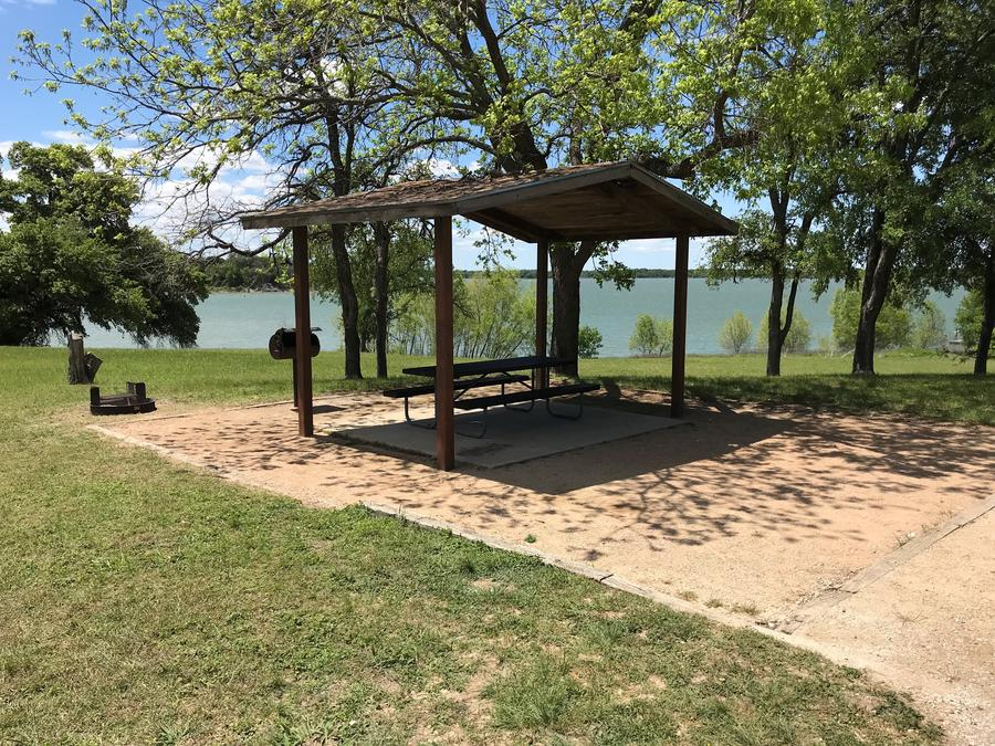 Covered picnic table, grill, and fire ring with great view of Waco Lake