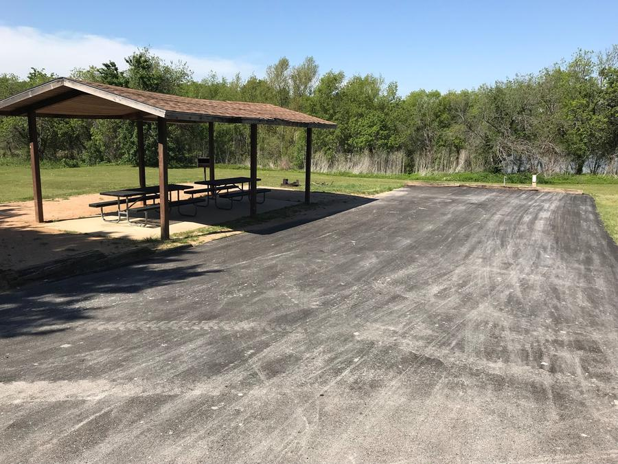 Double RV site with covered picnic tables, grill, and fire ring