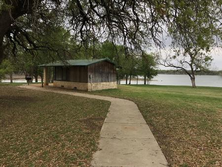 Screen shelter with Waco Lake in the background