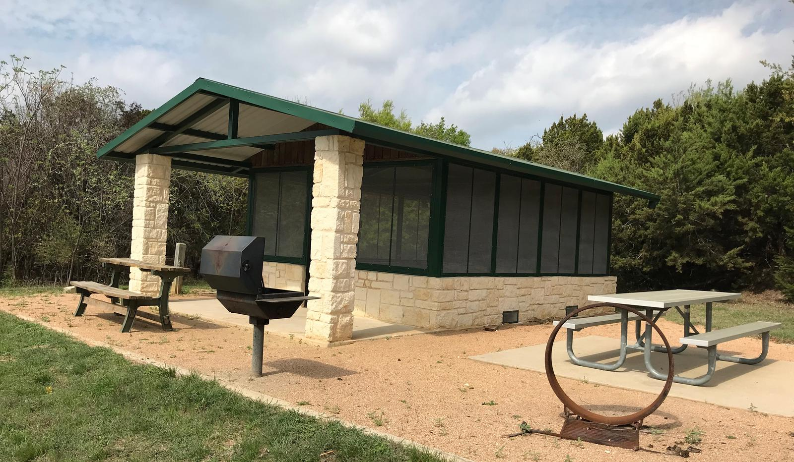 Screen shelter with picnic area, grill, and fire ring
