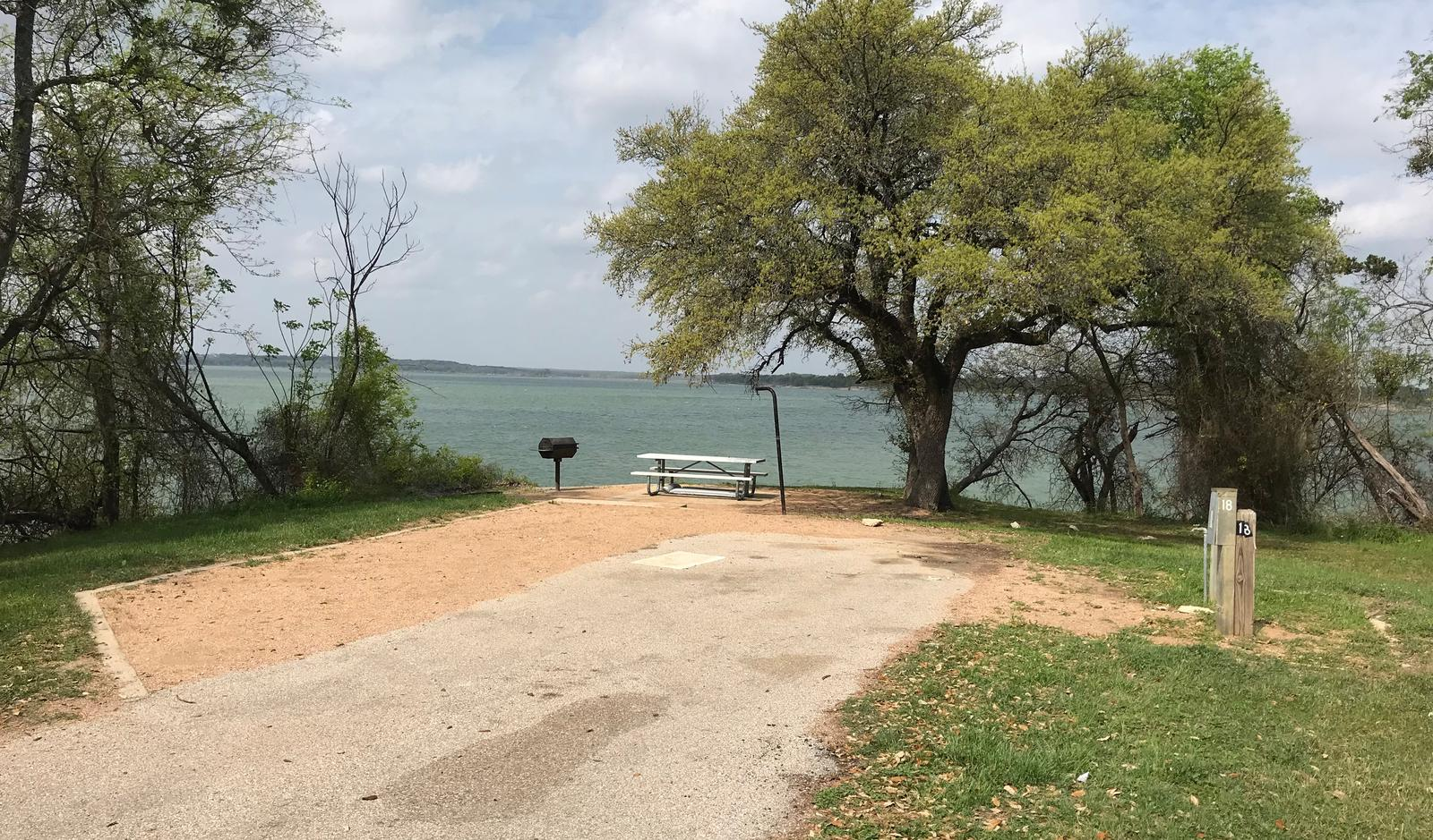 RV site with picnic table, grill, fire ring, and great view of Waco Lake