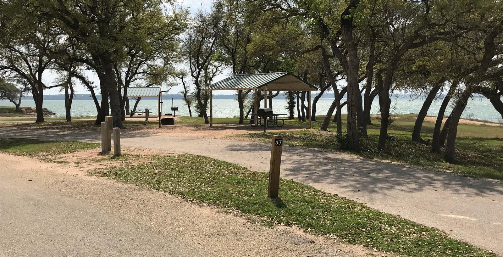 Pull through RV site with grill, fire ring, covered picnic table, and great view of Waco Lake