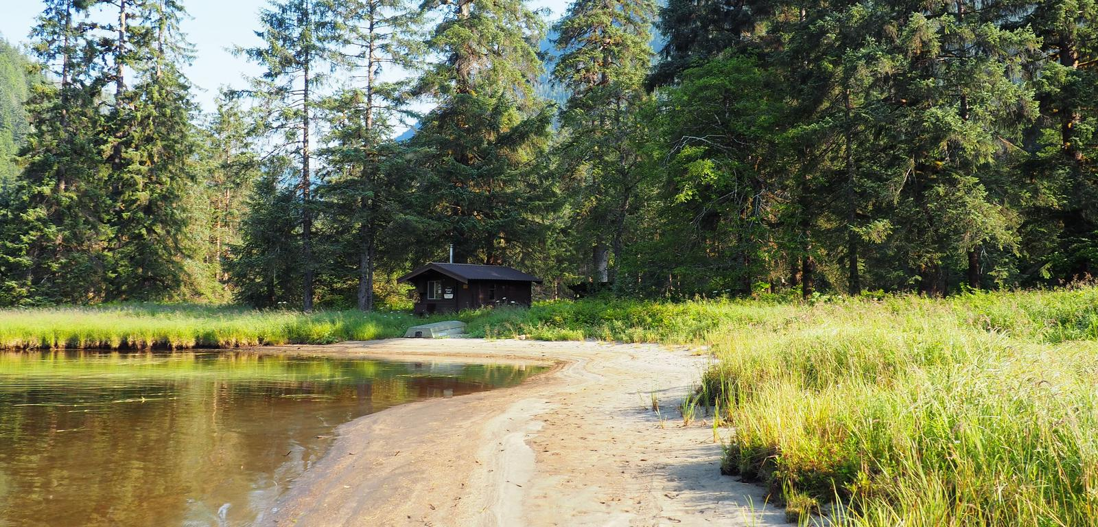 MARTEN LAKE CABIN WITH SURROUNDING SCENERY