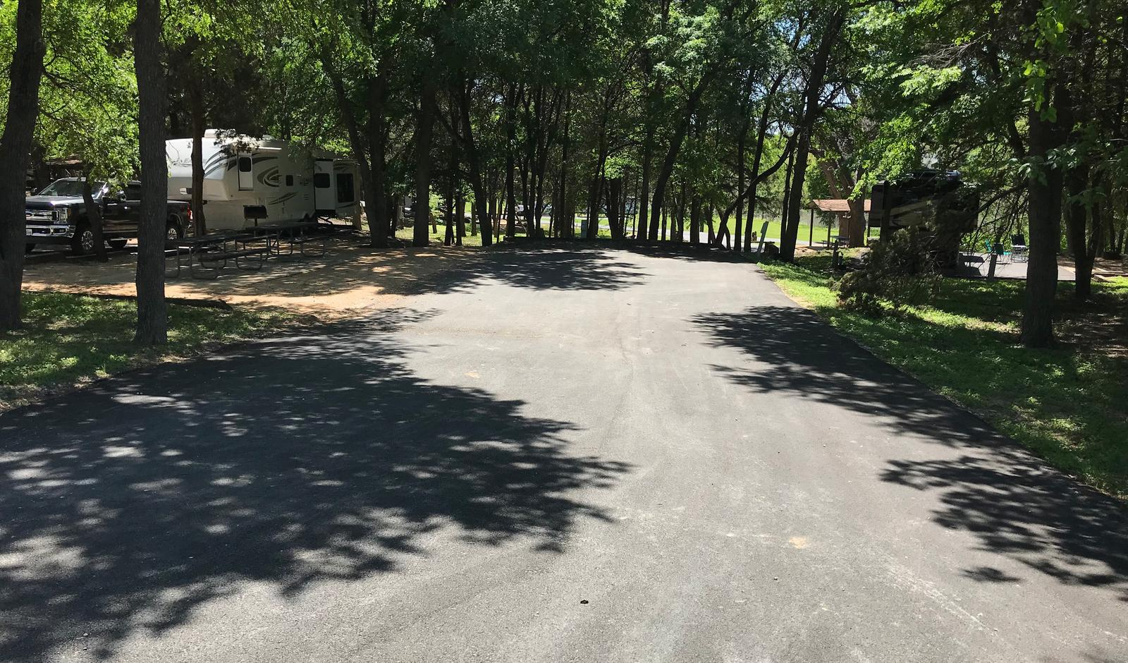 Double RV site with picnic tables, grill, and fire ring