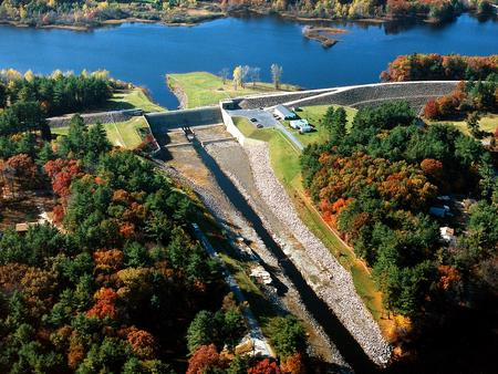 Aerial view of dam, project office and south end of lake.