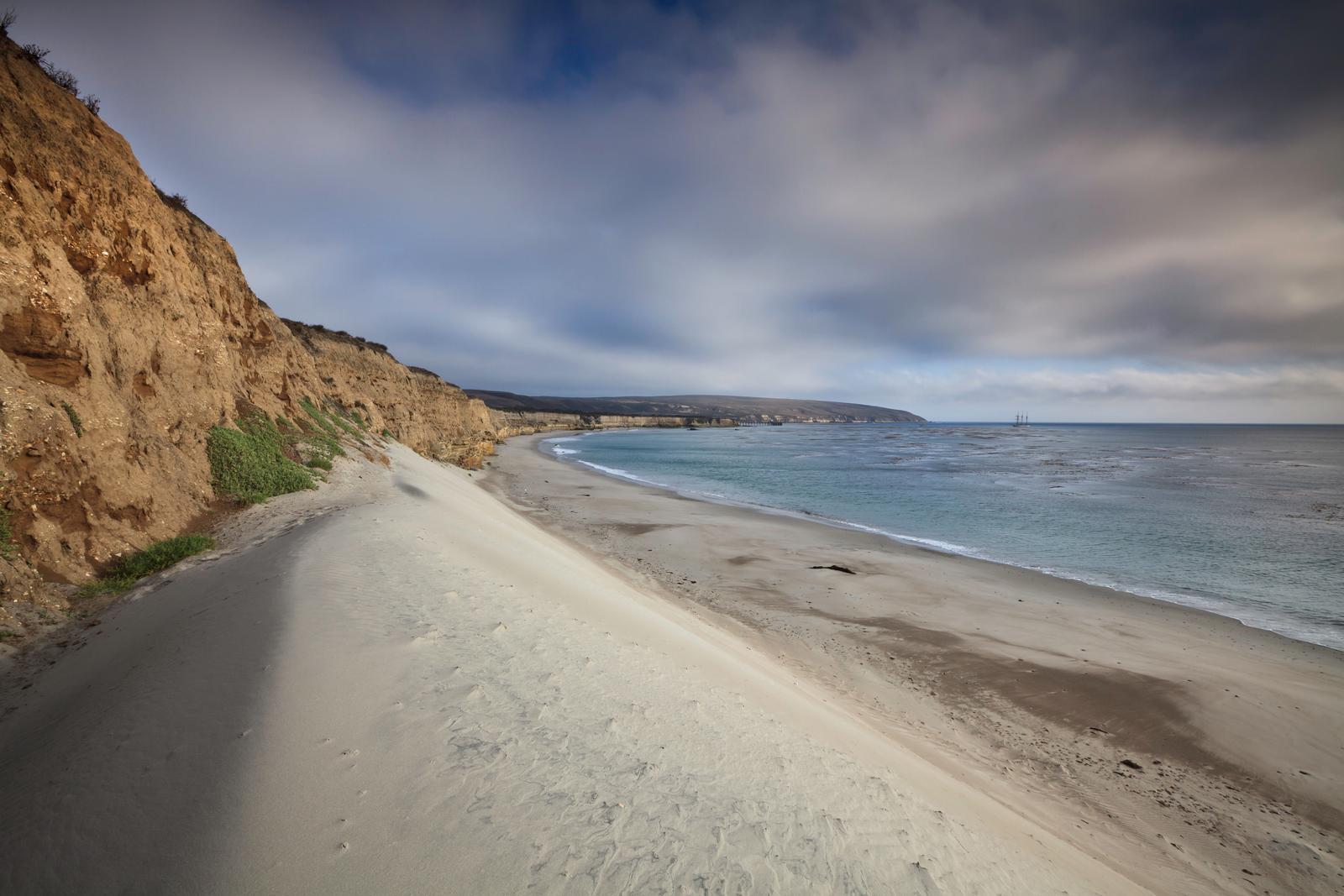 White sand dune next to a steep coastal bluff with ocean. Water Canyon Beach, Santa Rosa Island
