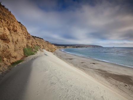 White sand dune next to a steep coastal bluff with oceanWater Canyon Beach, Santa Rosa Island