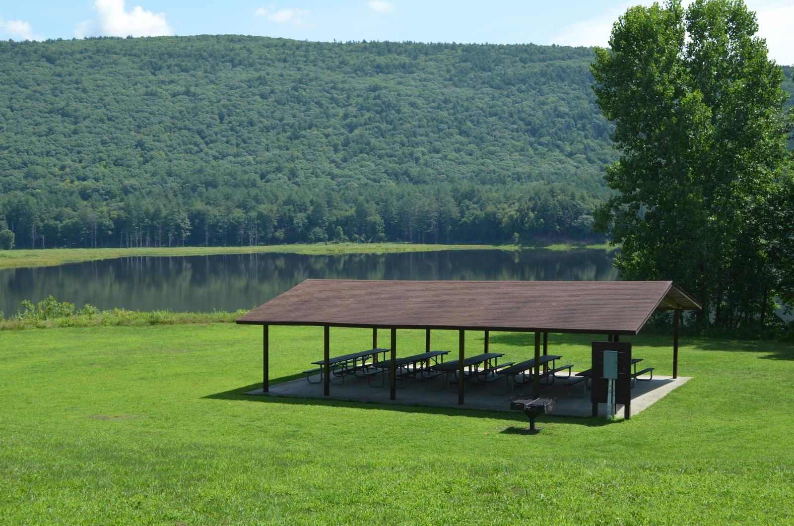 Aspen Shelter at Surry Mountain Lake Beach with the lake and the mountain in the backgroundAspen Shelter at Surry Mountain Lake Beach