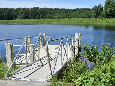 The Elm Brook Park fishing dock overlooking Hopkinton Lake on a sunny day.Fishing Dock