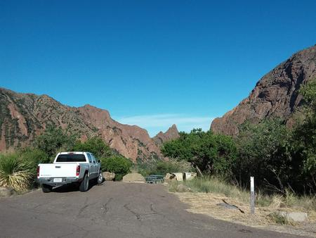 Parking spaces overlooking the campsite with mountains in the backgroundParking spaces overlooking the campsite