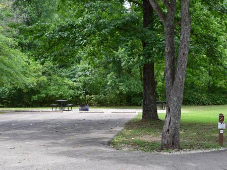 Campsite 2 showing double wide parking spur, picnic tables, lantern post and fire ringCampsite 2