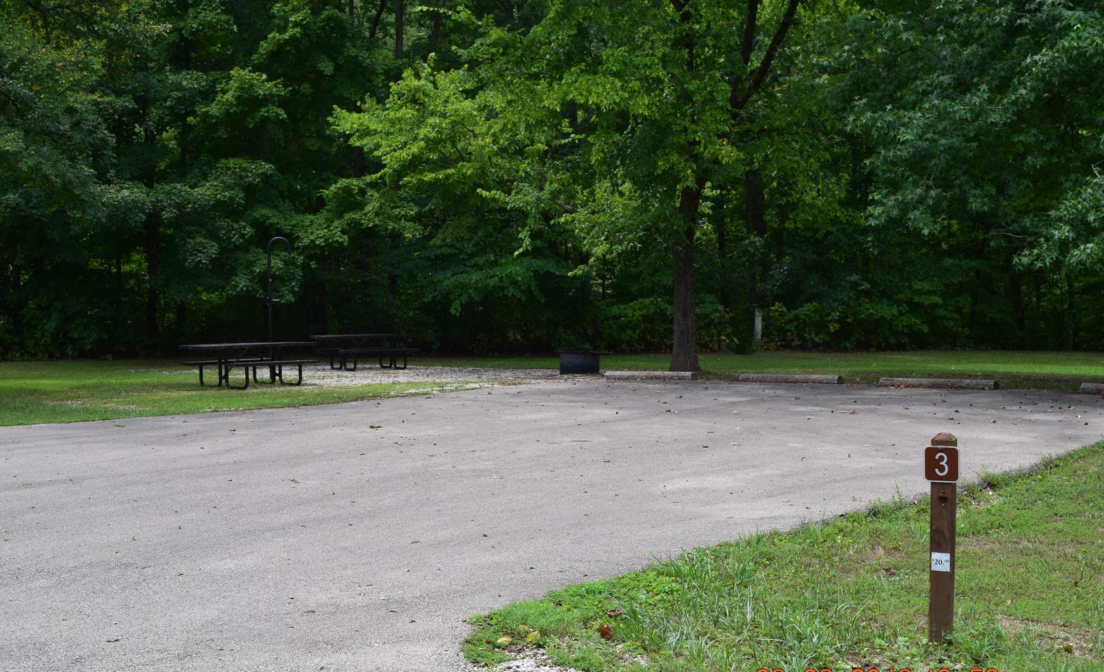 Campsite 3 show double wide parking spur, picnic tables, lantern post and fire ringCampsite 3