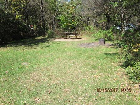 Loft Mountain Campground Site A76Picnic table and fire pit on campsite