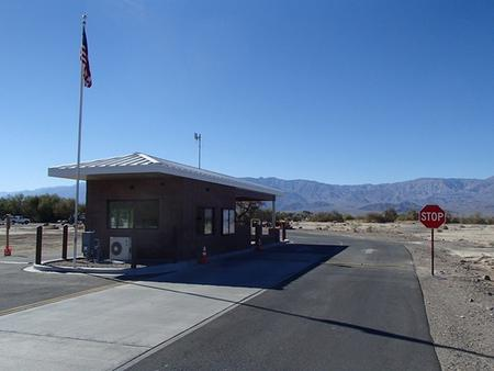 Building at the entrance of Furnace Creek CampgroundFurnace Creek Campground entrance kiosk.