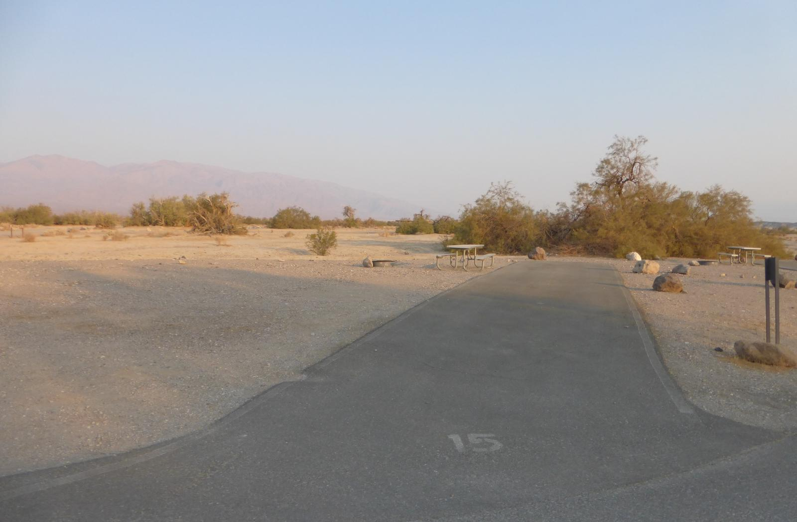 Furnace Creek Campground standard nonelectric site #15 with picnic table and fire ring.