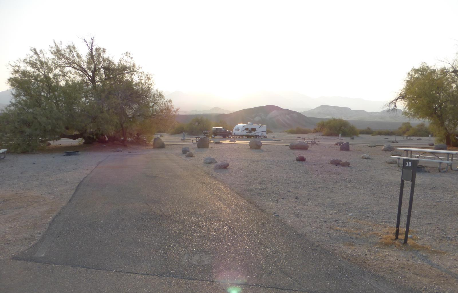 Furnace Creek Campground standard nonelectric site #18 with picnic table and fire ring.