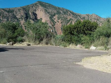 Parking spaces for site R, mountains in the backgroundParking spaces for site R
