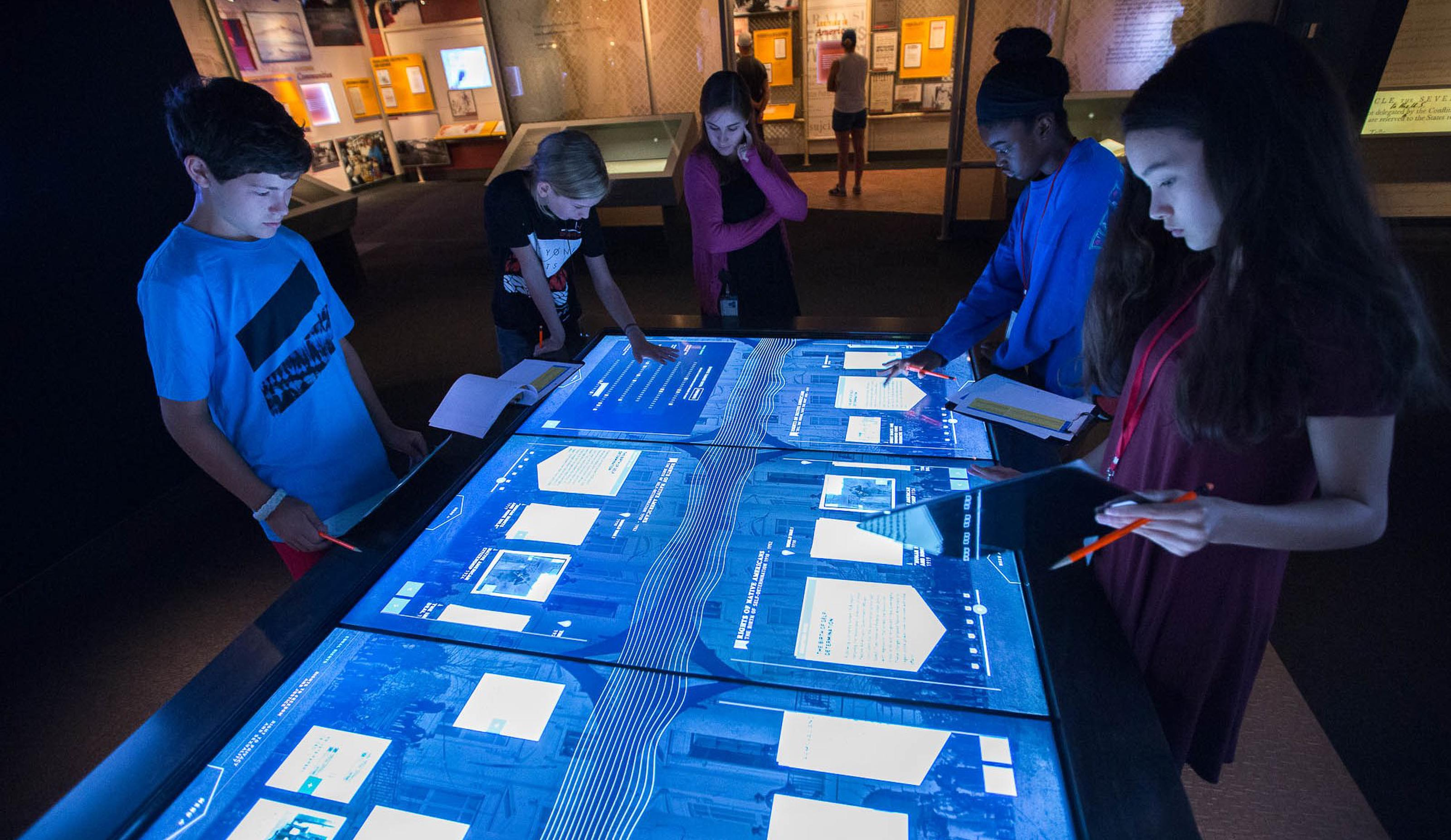 Visitors exploring records on an interactive table