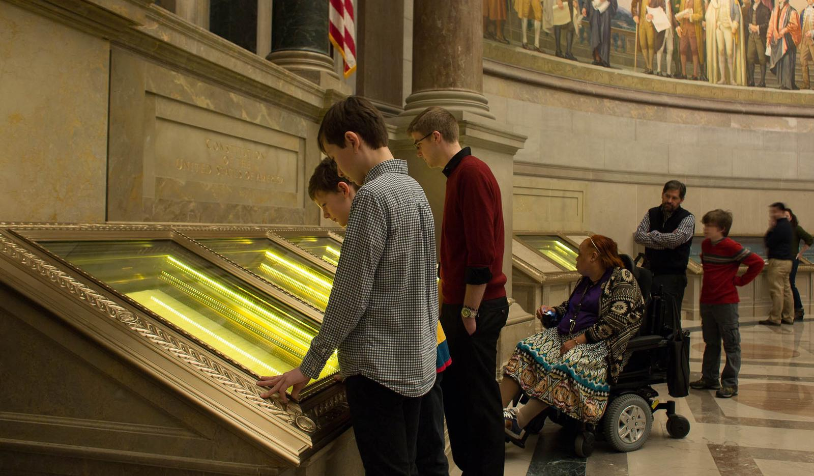 Visitors viewing the U.S. Constitution in the Rotunda for the Charters of Freedom