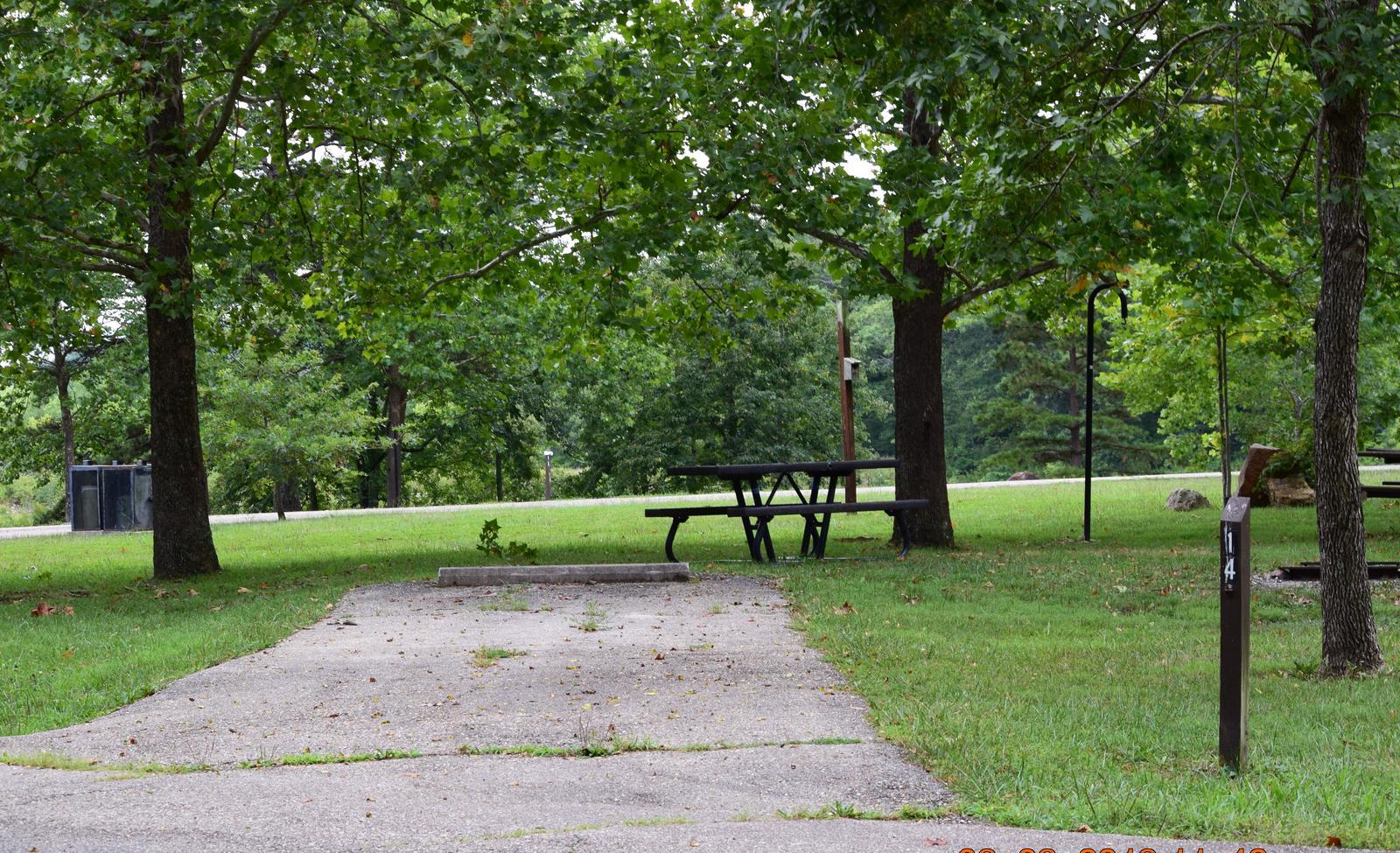 Campsite 14 showing parking spur, picnic table and lantern postCampsite 14