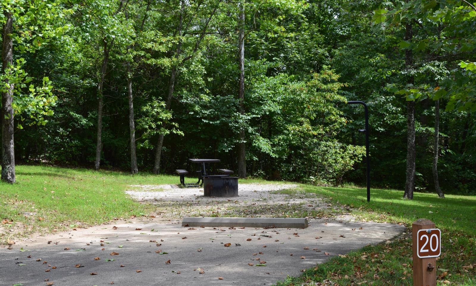 Campsite 20 showing parking spur, picnic table, lantern post and fire ringCampsite 20