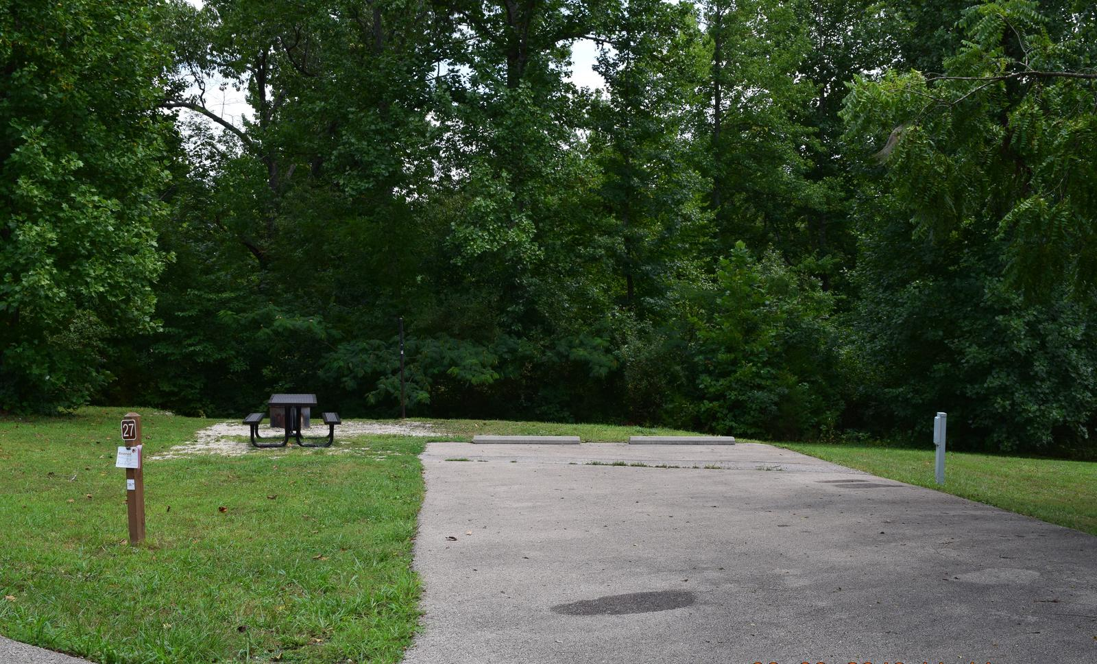 Campsite 27 showing parking spur, picnic table, lantern post, electric hookup and fire ring.Campsite 27