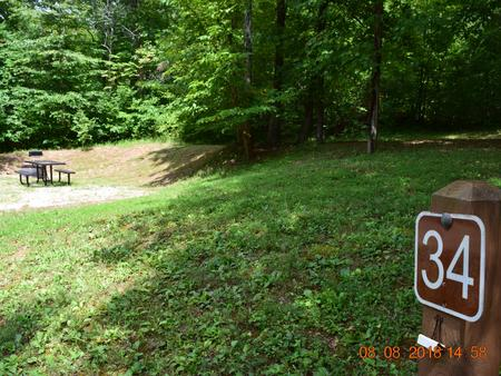 Campsite 34 showing number post, picnic table and fire ringCampsite 34