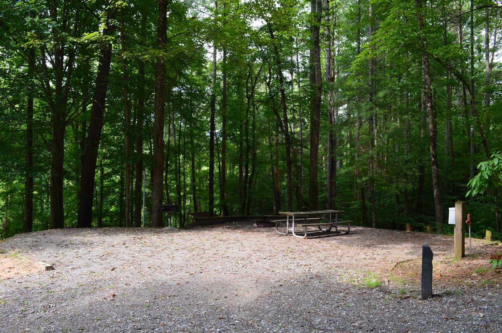 Gravel site with fire pit, table, grill Gravel site with fire pit, table, grill