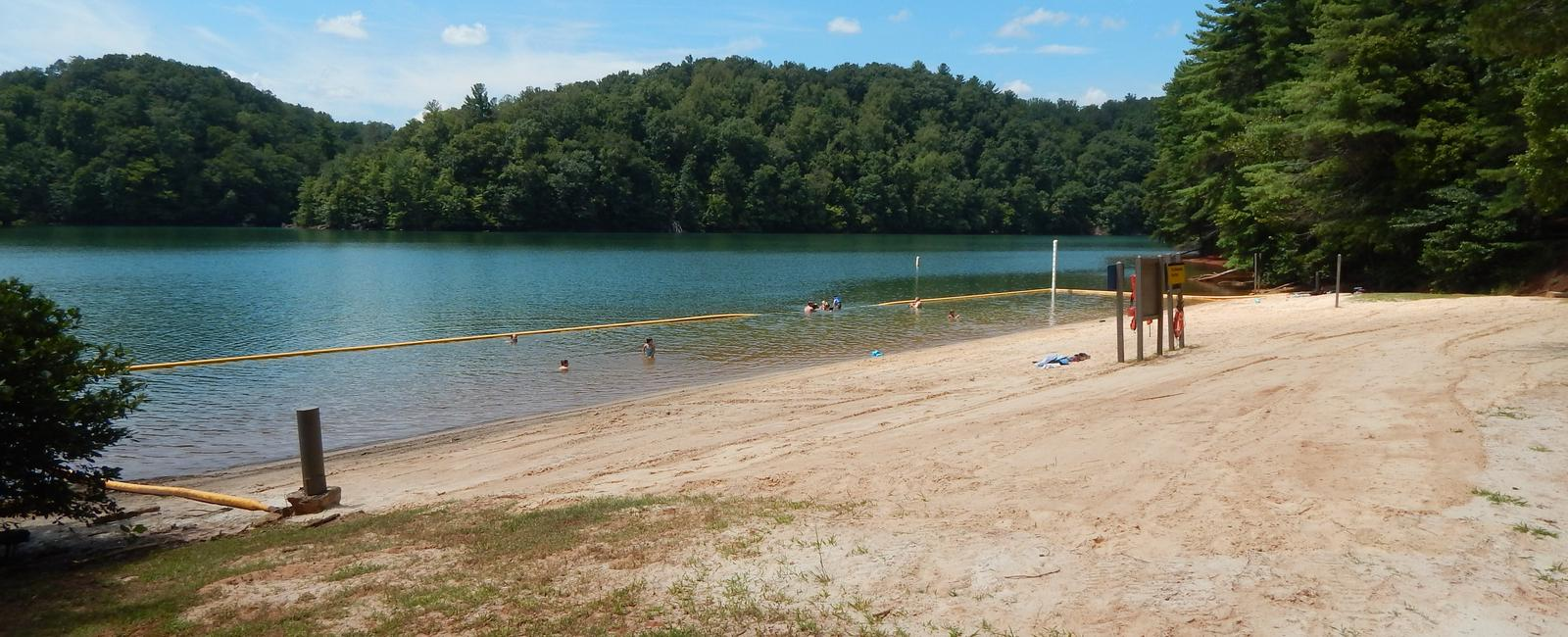 Large sandy beach and roped-off swim area at Horseshoe Point. Horseshoe Point beach and swim area.