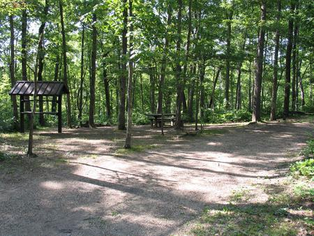Campsite 31 showing parking spur, picnic table and food shelter.Campsite 31