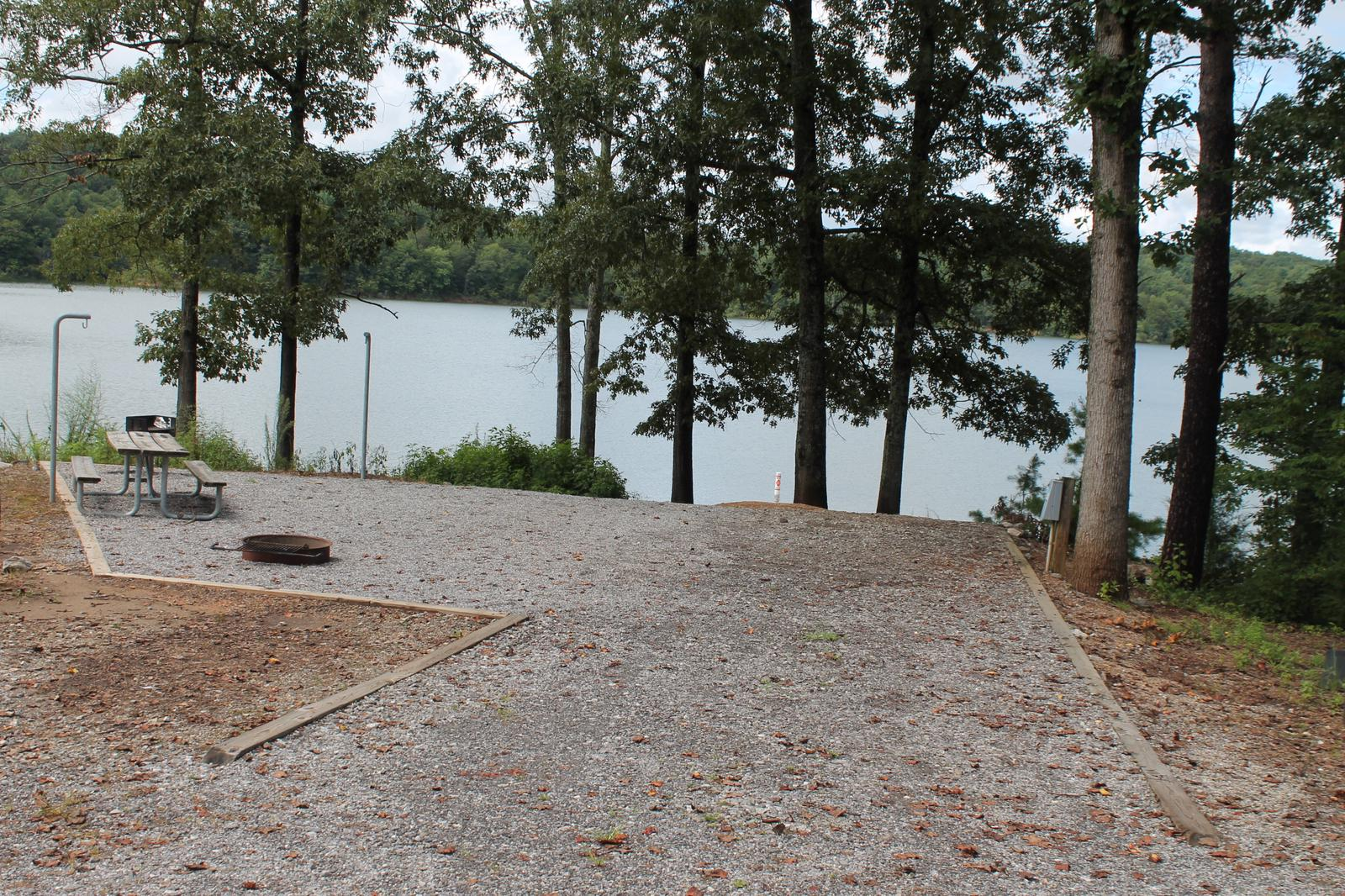 Short gravel pull in to site with table, fire pit, and grill with views of the lake Shorter gravel pull in to site with table, fire pit, and grill